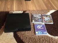 PlayStation 3 slim with 3 games and controller