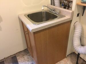 Used Laundry sink and cabinet