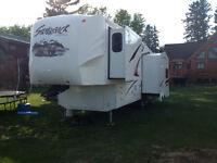 Like new Cedar Creek Silverback 29 RL. fifth wheel trailer
