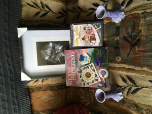 Yard sale items candle holders, glass painting book, photo frame