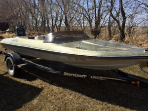 150hp boat with shoreland'r trailer.