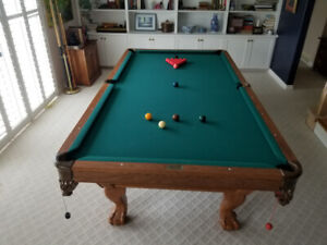 Beautiful pool table 3 cues and holder and Boston /snooker balls