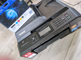 Brother Professional Series MFC-J5910DW printer with ink
