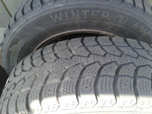 4  185/65 R14 Winter Claw Tires and Rims