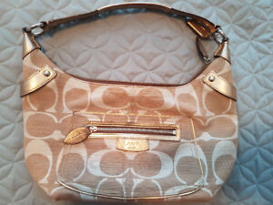 Like new Authentic Coach purse selling for