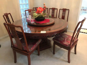 Rosewood dining table, glass top, eight chairs, lazy susan