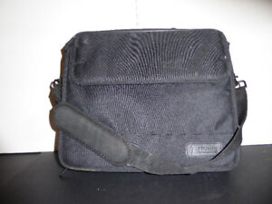 BLACK CANVAS OVERNIGHT CARRYING CASE OR CAN USE AS A BRIEFCASE
