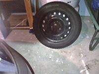 SET OF FOUR SNOW TIRES MOUNTED ON STEEL RIMS