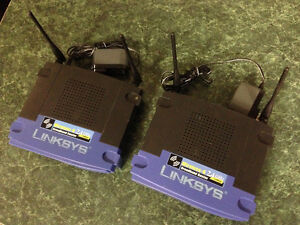 Two Linksys 2.4 GHz Routers WRT54G V8