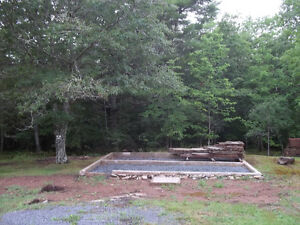 Half Acre of land with drilled well in Newburne, Lun Co./Selling