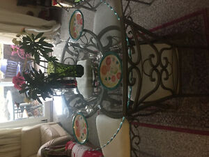 Glass table with four chairs for sale .....
