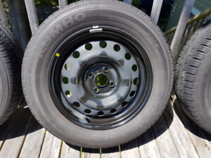 Kumho Solus KH25  all-season tires and 15 inch rims