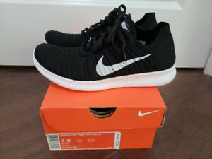 Brand new in box women's Nike Free Run Flyknit black US7.5
