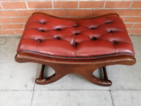 A Red Leather Chesterfield Saddle Foot Stool