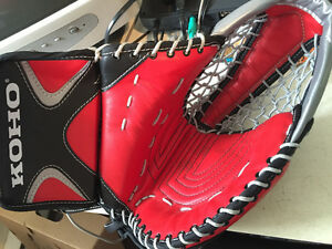 Brand new Koho goalie glove( red, black and silver)