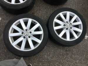 "A pair of 17"" Volkswagen Golf Alloy Rims with Tires"