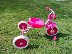 Two kids tricycles
