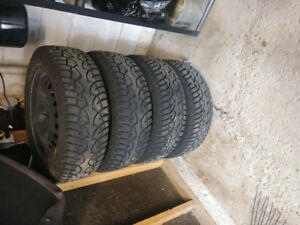 Winter tires and rims for a 2011 GMC Terrain SLT. 225/60 R17