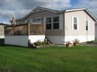 Beautiful Double wide on Corner Lot in Parkland Village $149,900