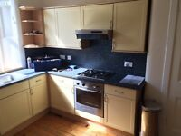 Kitchen with oven and extractor hood