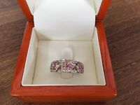 Pink sapphire & diamond 9ct gold band ring.