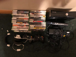 Xbox 360 with 31 games two wireless controllers head set Kinect.