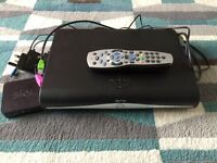 Sky+ HD box, mini wireless connector, remote control, HD cable and power cables.