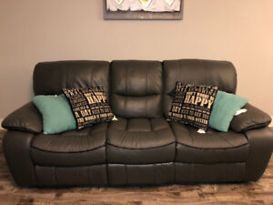 Like new , excellent condition, synthetic leather reclining sofa