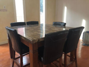 Elegant stone-top dining table in great condition!