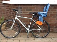 Child bike seat (2 available, £30 each).