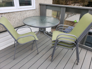 Round glass patio set with 4 chairs and umbrella