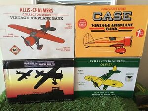 Lot of 7 Die Cast Plane Coin Banks