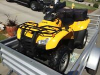 Mint condition Honda 4x4 quad and trailer package!