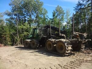 wood harvester and wood porter and trailer