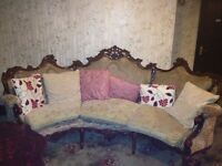 Victorian style sofa with mahogany trim and two armchairs