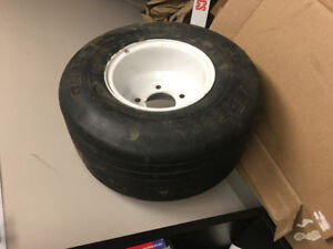 Wheel with tires 18x8.5-8 NHS 5 bolt
