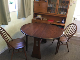 Ercol dining table and 2 chairs