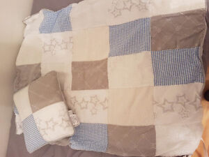Crib quilt and matching pillow
