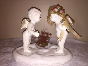 Set of 2 kissing ceramic angels on a base