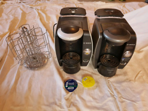 2 tassimo coffee makers and carasel