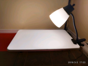 Folding desk on the bed