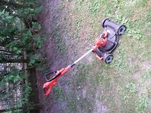 NEW Electric Black and Decker Lawnmower Trimmer Used Once