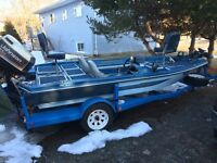 Bass boat , 125 johnson outboard and trailer