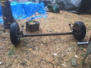 Trailer axle with tire assemblies