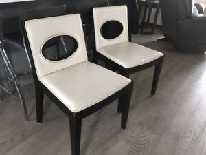 6 cream coloured leather dining chairs with black hardwood trim