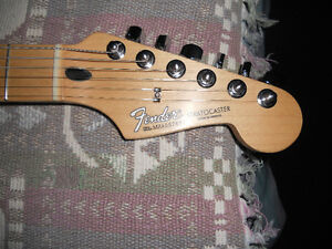 Fender stratocaster SSH made in mexico 2004 ( très beau son )
