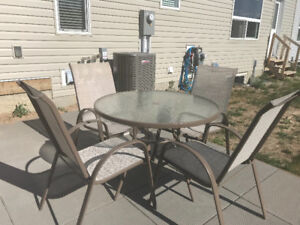 Out door table and 4 chairs with umbrella good condition