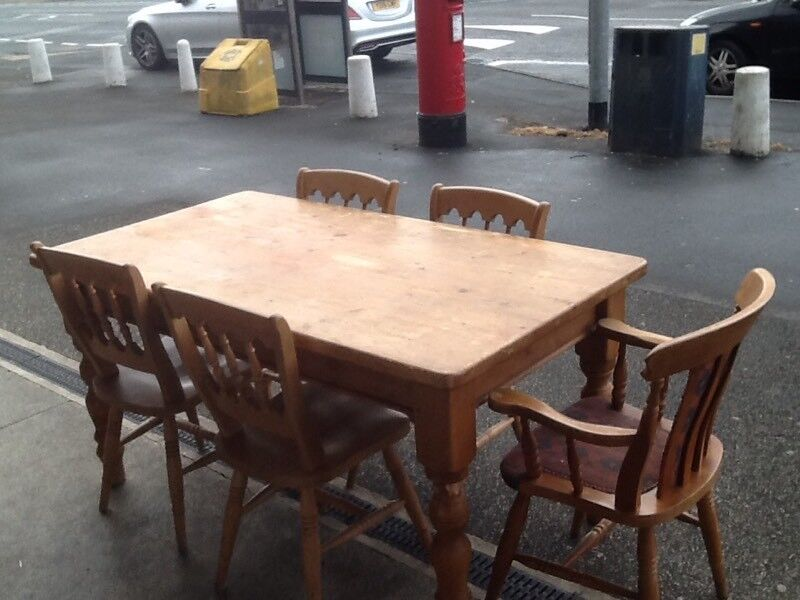 Pine farmhouse table and 4 pine farmhouse chairs and carver