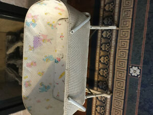 Antique wicker baby cradle