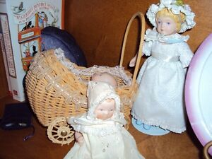 vintage miniature china dolls and wicker carriage
